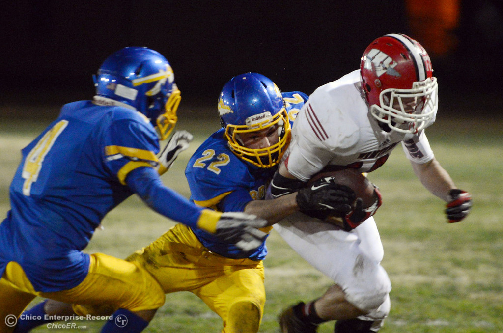 . Hamilton High\'s #4 Angel Montes (left) watches #32 Tim Bekendam (center) tackle against Winters High\'s #10 Ben Case (right) in the second quarter of their football game at HHS on Wednesday, November 27, 2013 in Hamilton City, CA.  (Jason Halley/Chico Enterprise-Record)