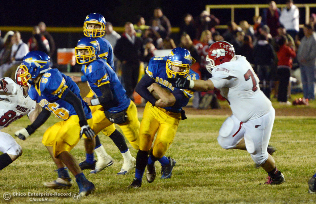 . Hamilton High\'s #33 Andrew Shippelhoute (left) rushes against Winters High\'s #76 Adrian Combs (right) in the second quarter of their football game at HHS Wednesday, November 27, 2013 in Hamilton City, Calif.  (Jason Halley/Chico Enterprise-Record)