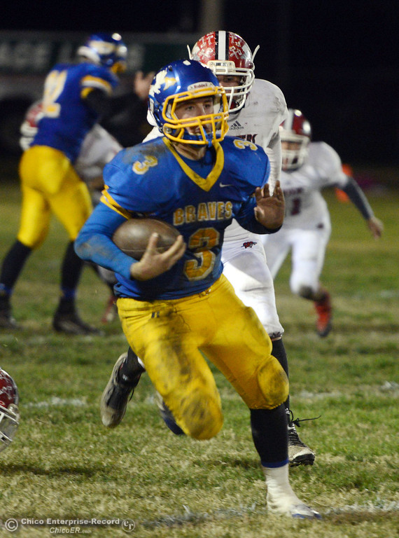 . Hamilton High\'s #3 Austin Burbank against Winters High in the third quarter of their football game at HHS Wednesday, November 27, 2013 in Hamilton City, Calif.  (Jason Halley/Chico Enterprise-Record)