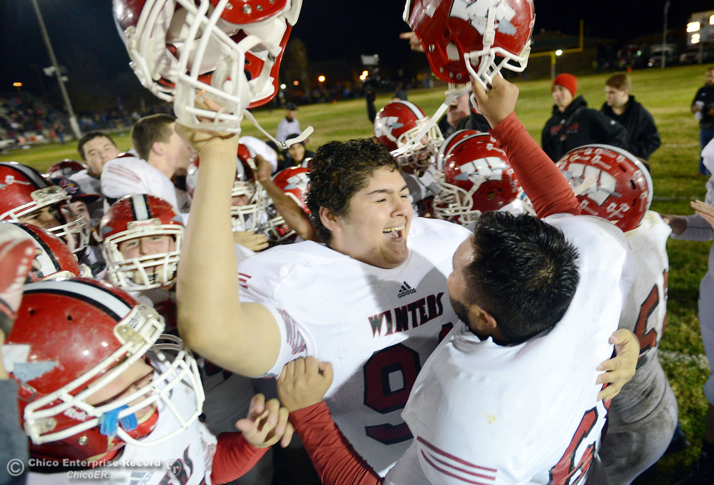 . Winters High celebrate their win against Hamilton High at the end of the fourth quarter of their football game at HHS Wednesday, November 27, 2013 in Hamilton City, Calif.  (Jason Halley/Chico Enterprise-Record)