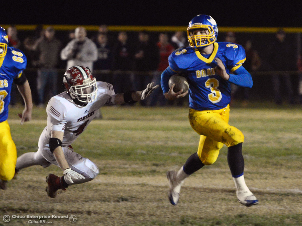 . Hamilton High\'s #3 Austin Burbank (right) rushes against Winters High\'s #4 Chaz Matthews (left) in the first quarter of their football game at HHS Wednesday, November 27, 2013 in Hamilton City, Calif.  (Jason Halley/Chico Enterprise-Record)