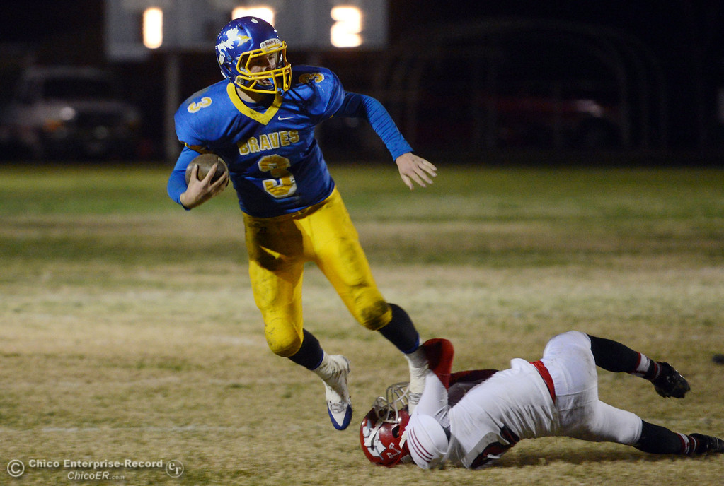 . Hamilton High\'s #3 Austin Burbank (left) breaks the tackle to score a touchdown against Winters High\'s #2 Christian Corrales (right) in the second quarter of their football game at HHS Wednesday, November 27, 2013 in Hamilton City, Calif.  (Jason Halley/Chico Enterprise-Record)