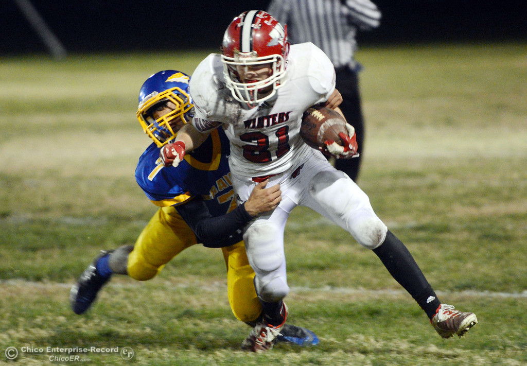 . Hamilton High\'s #7 Ricky Pompa (left) rushes against Winters High\'s #21 Trevor Ray (right) in the third quarter of their football game at HHS Wednesday, November 27, 2013 in Hamilton City, Calif.  (Jason Halley/Chico Enterprise-Record)