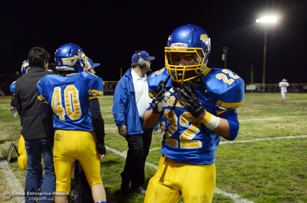 . Hamilton High\'s #22 Luis Ojeda (right) comes off the field against Winters High in the first quarter of their football game at HHS Wednesday, November 27, 2013 in Hamilton City, Calif.  (Jason Halley/Chico Enterprise-Record)