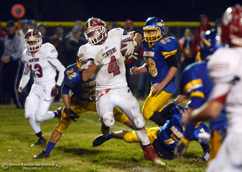 . Winters High\'s #4 Chaz Matthews (center) rushes against Hamilton High in the third quarter of their football game at HHS Wednesday, November 27, 2013 in Hamilton City, Calif.  (Jason Halley/Chico Enterprise-Record)