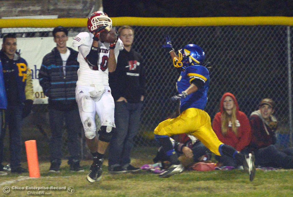 . Winters High\'s #10 Ben Case (left) completes a catch against Hamilton High\'s #2 Theron Fumasi (right) in the third quarter of their football game at HHS Wednesday, November 27, 2013 in Hamilton City, Calif.  (Jason Halley/Chico Enterprise-Record)