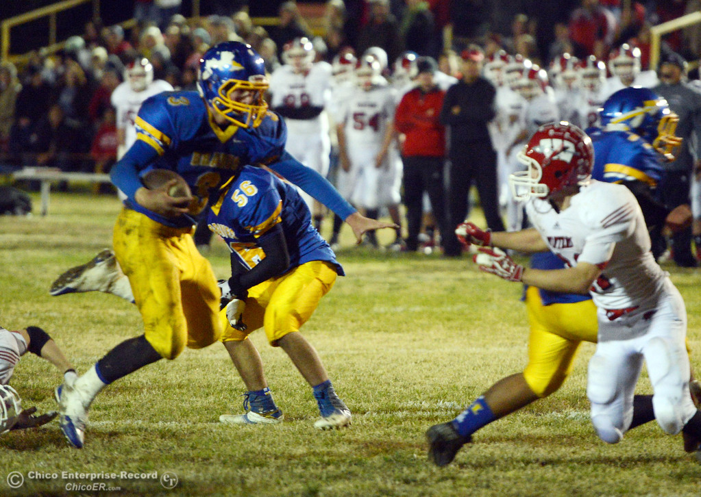 . Hamilton High\'s #3 Austin Burbank (left) rushes against Winters High\'s #21 Trevor Ray (right) in the second quarter of their football game at HHS Wednesday, November 27, 2013 in Hamilton City, Calif.  (Jason Halley/Chico Enterprise-Record)