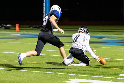 Dominion's Aiden Dolan recovers a bad snap to prevent a turnover.