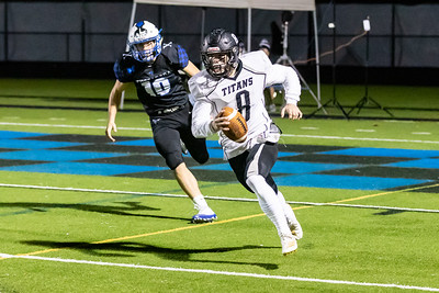QB Aiden Dolan scrambles after avoiding a sack in the end zone