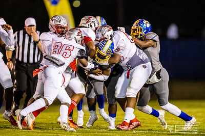 Crisp County offensive player gets taken down and stopped by the Jenkins defense.[HUNTER D. CONE/SAVANNAHNOW.COM]