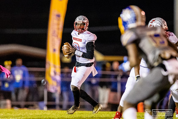 Jenkins quarterback Patrick Blake (2) looks back to pass in the third round GHSA playoffs. [HUNTER D. CONE/SAVANNAHNOW.COM]