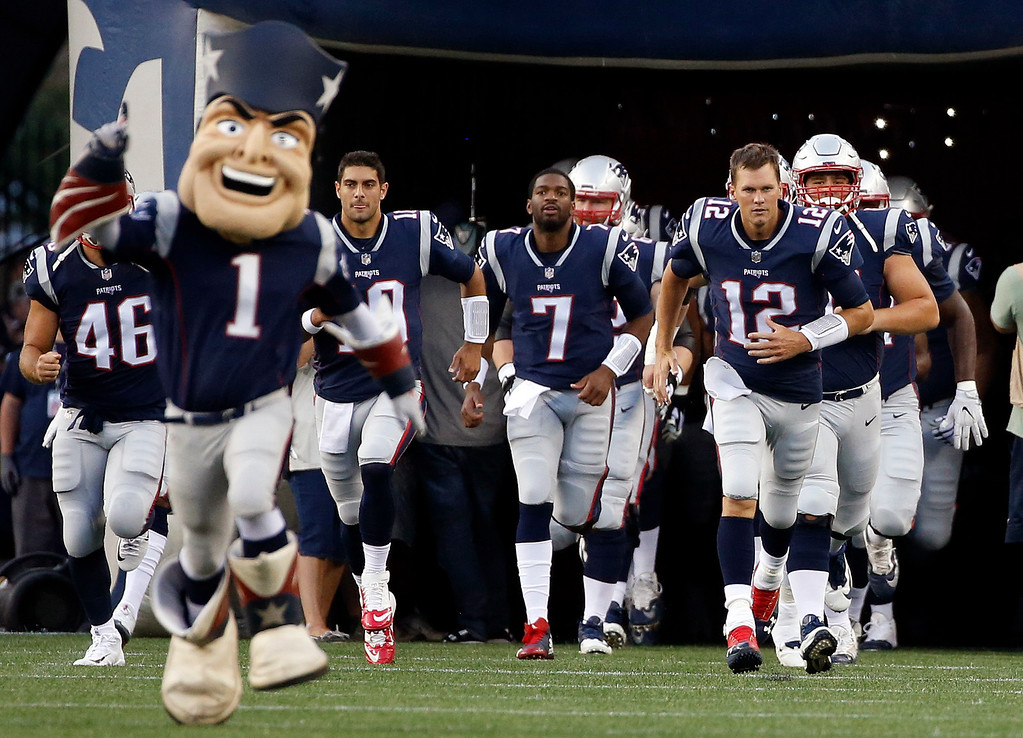 . New England Patriots quarterback Tom Brady (12) leads his team onto the field for an NFL preseason football game against the Jacksonville Jaguars, Thursday, Aug. 10, 2017, in Foxborough, Mass. (AP Photo/Mary Schwalm)