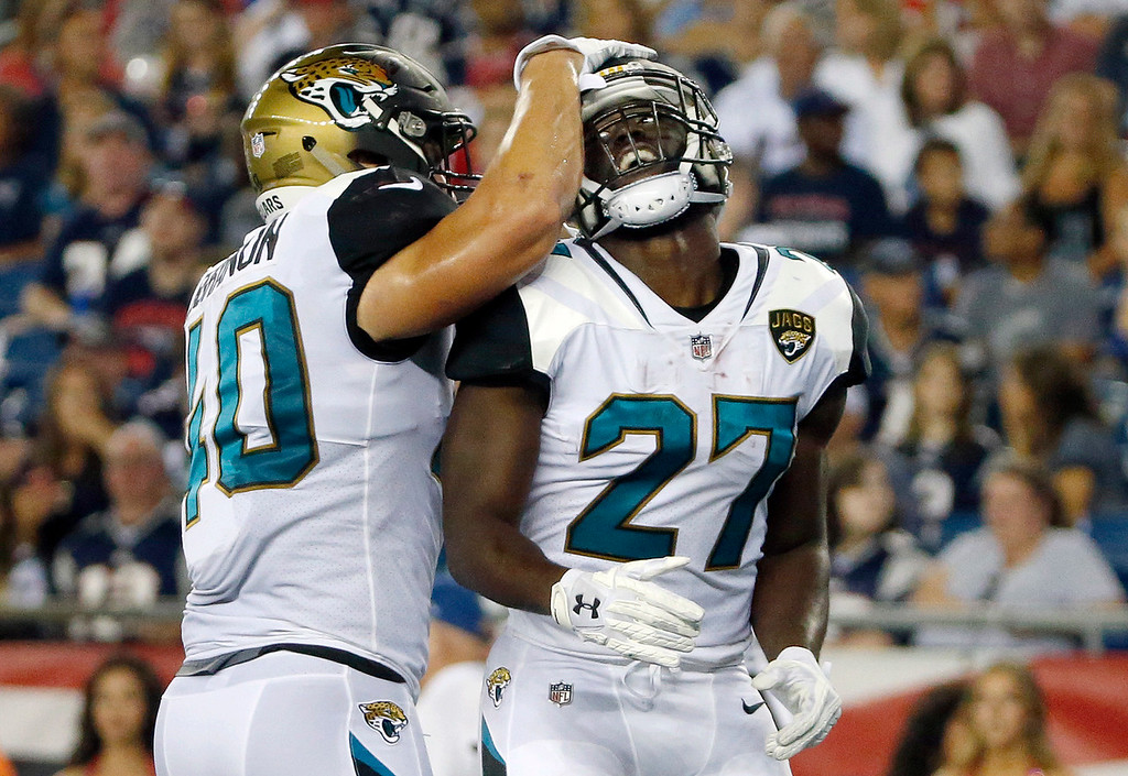 . Jacksonville Jaguars running back Leonard Fournette (27) celebrates his touchdown against the New England Patriots with Tommy Bohanon, left, in the first half of an NFL preseason football game, Thursday, Aug. 10, 2017, in Foxborough, Mass. (AP Photo/Mary Schwalm)