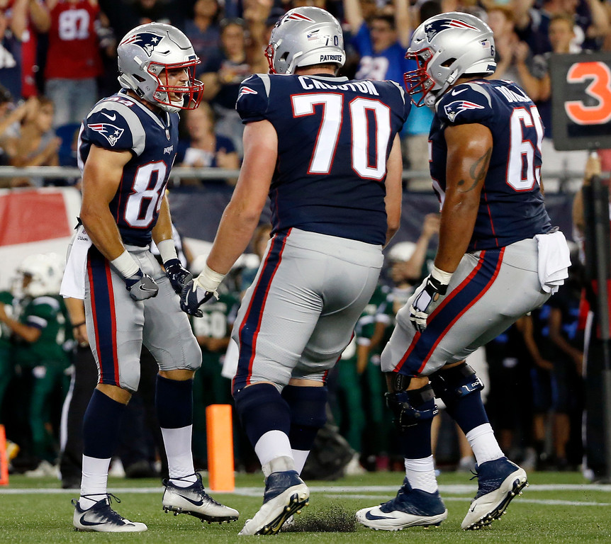 . New England Patriots wide receiver Austin Carr, left, celebrates his touchdown catch against the Jacksonville Jaguars with teammates in the first half of an NFL preseason football game, Thursday, Aug. 10, 2017, in Foxborough, Mass. (AP Photo/Mary Schwalm)