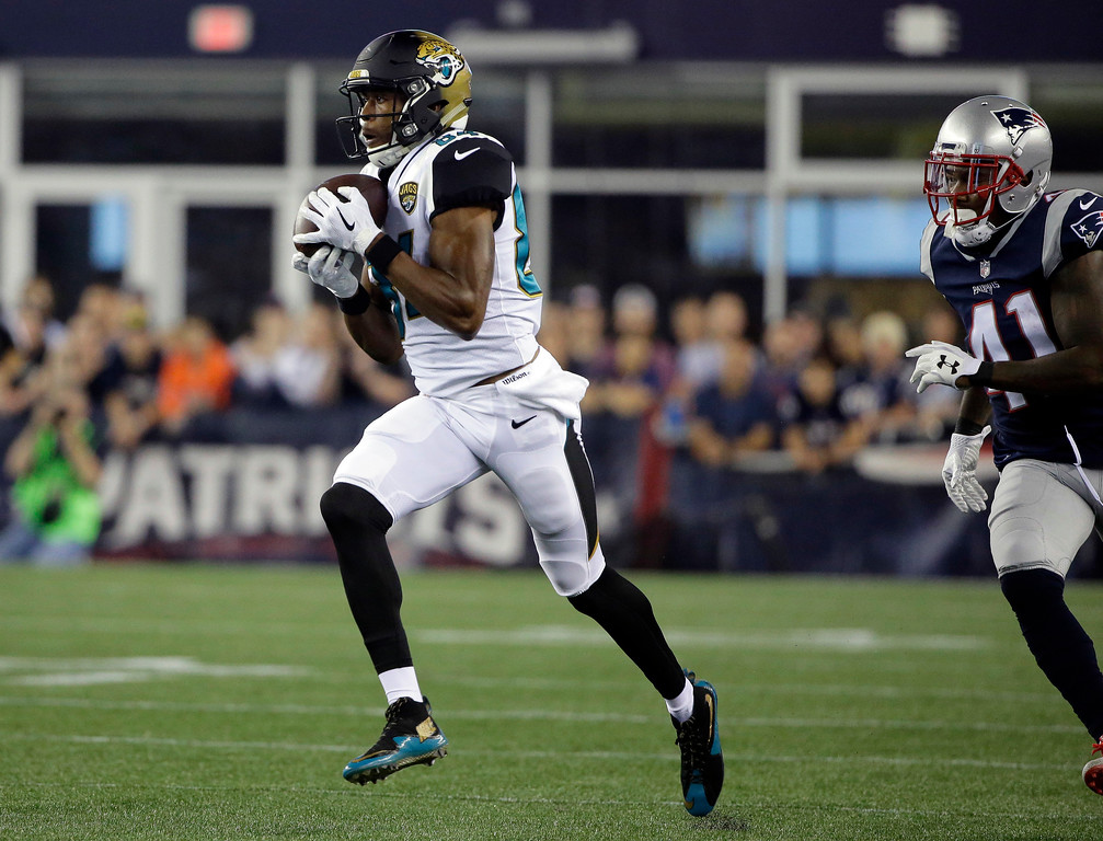 . Jacksonville Jaguars wide receiver Keelan Cole, left, catches a pass in front of New England Patriots cornerback Cyrus Jones (41) and runs for a touchdown in the first half of an NFL preseason football game, Thursday, Aug. 10, 2017, in Foxborough, Mass. (AP Photo/Steven Senne)