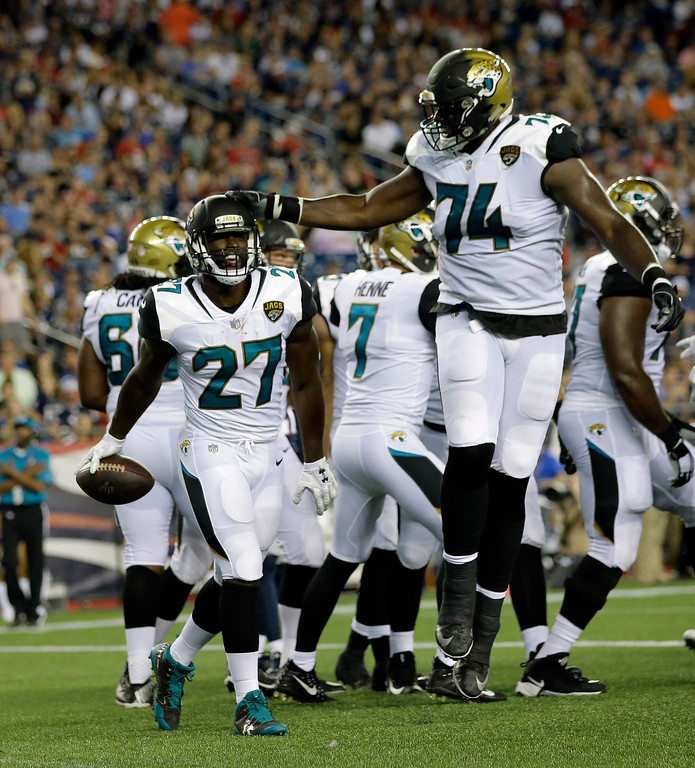 . Jacksonville Jaguars running back Leonard Fournette (27) celebrates his touchdown against the New England Patriots with Cam Robinson (74) in the first half of an NFL preseason football game, Thursday, Aug. 10, 2017, in Foxborough, Mass. (AP Photo/Steven Senne)
