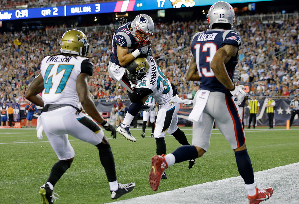 . New England Patriots wide receiver Austin Carr, center, catches a touchdown pass in the grasp of Jacksonville Jaguars cornerback Tracy Howard (36) in the first half of an NFL preseason football game, Thursday, Aug. 10, 2017, in Foxborough, Mass. (AP Photo/Steven Senne)