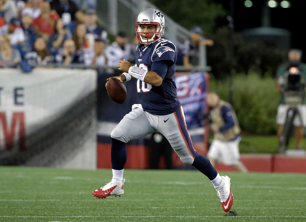 . New England Patriots quarterback Jimmy Garoppolo scrambles against the Jacksonville Jaguars in the first half of an NFL preseason football game, Thursday, Aug. 10, 2017, in Foxborough, Mass. (AP Photo/Steven Senne)
