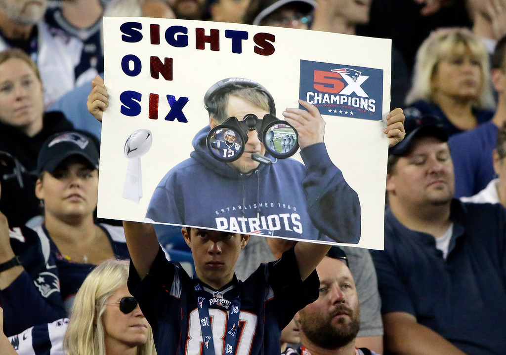 . A New England Patriots fan holds a sign about the team\'s Super Bowl championship in the first half of an NFL preseason football game against the Jacksonville Jaguars, Thursday, Aug. 10, 2017, in Foxborough, Mass. (AP Photo/Steven Senne)
