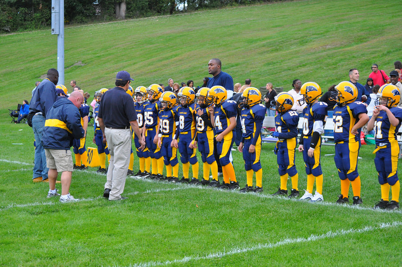 Jr. Pee Wee Panthers getting their pregame peptalk.