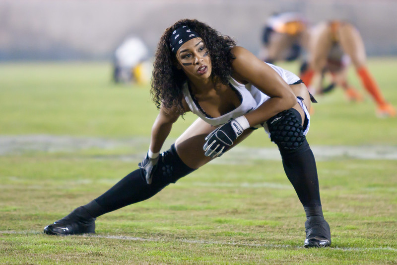 Zipporah Chase stretches during pre-game warmups