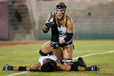 Melissa Margulies (Los Angeles Temptation) helps a teammate stretch during pre-game warmups