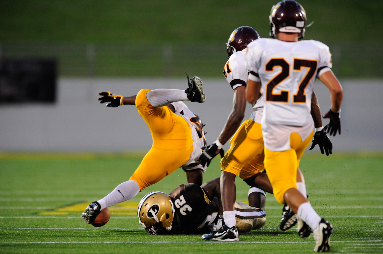 Sept 9, 2011 : McNamara' s Kevaugn Townsend (44) fumbles the ball during action at the 2011 Patriot Classic Football tournament at the United States Naval Academy Stadium in Annapolis, Maryland. The Landon Bears defeated the McNamara team 29-14.