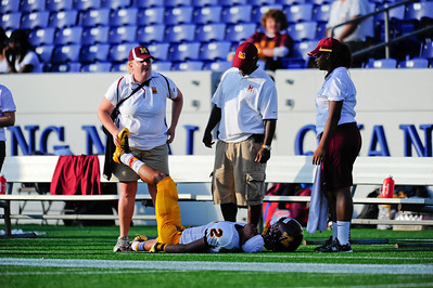 Sept 9, 2011 : McNamara's WR Britton Savoy (2) gets stretched out with a trainer during action at the 2011 Patriot Classic Football tournament at the United States Naval Academy Stadium in Annapolis, Maryland. The Landon Bears defeated the McNamara team 29-14.