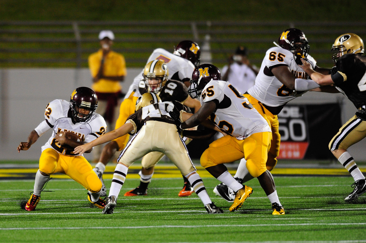 Sept 9, 2011 : McNamara's RB Adam Gillis (22) rushes during action at the 2011 Patriot Classic Football tournament at the United States Naval Academy Stadium in Annapolis, Maryland. The Landon Bears defeated the McNamara team 29-14.