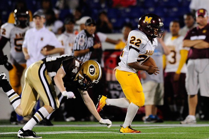 Sept 9, 2011 : McNamara's RB Adam Gillis (22) rushes for a TD during action at the 2011 Patriot Classic Football tournament at the United States Naval Academy Stadium in Annapolis, Maryland. The Landon Bears defeated the McNamara team 29-14.