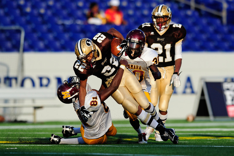 Sept 9, 2011 : Landon's WR (22) Joe McDonald gets tackled during action at the 2011 Patriot Classic Football tournament at the United States Naval Academy Stadium in Annapolis, Maryland. The Landon Bears defeated the McNamara team 29-14.