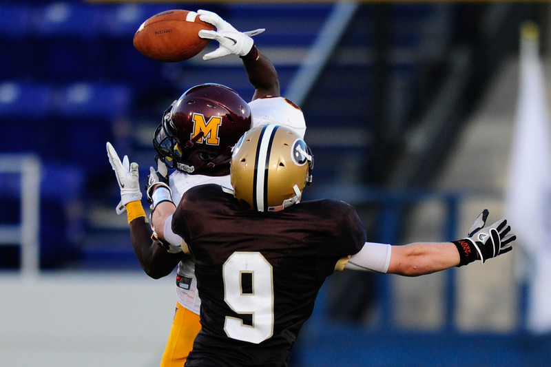 Sept 9, 2011 : McNamara's Tony Squirewell Jr. (23) jumps to make a catch while being defended by Landon's Peter Laco (9)  during action at the 2011 Patriot Classic Football tournament at the United States Naval Academy Stadium in Annapolis, Maryland. The Landon Bears defeated the McNamara team 29-14.