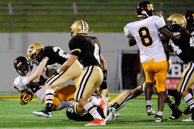Sept 9, 2011 : McNamara' s Kevaugn Townsend (44) gets tackled during action at the 2011 Patriot Classic Football tournament at the United States Naval Academy Stadium in Annapolis, Maryland. The Landon Bears defeated the McNamara team 29-14.