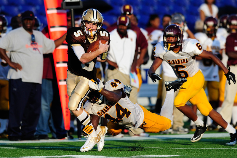 Sept 9, 2011 : Landon's QB Charlie Schnider (5) tries to avoid the tackle of McNamara's Kevaugn Townsend (44) during action at the 2011 Patriot Classic Football tournament at the United States Naval Academy Stadium in Annapolis, Maryland. The Landon Bears defeated the McNamara team 29-14.