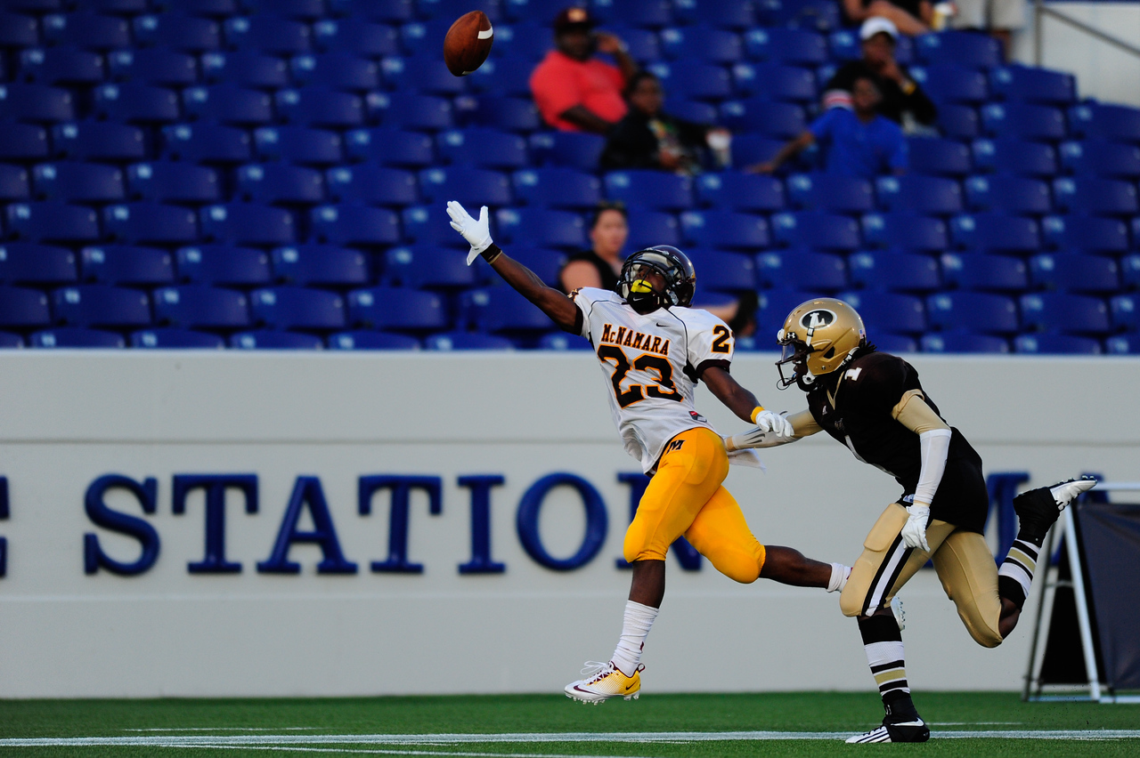 Sept 9, 2011 : McNamara's Tony Squirewell Jr. (23) reaches for an overthrown pass during action at the 2011 Patriot Classic Football tournament at the United States Naval Academy Stadium in Annapolis, Maryland. The Landon Bears defeated the McNamara team 29-14.