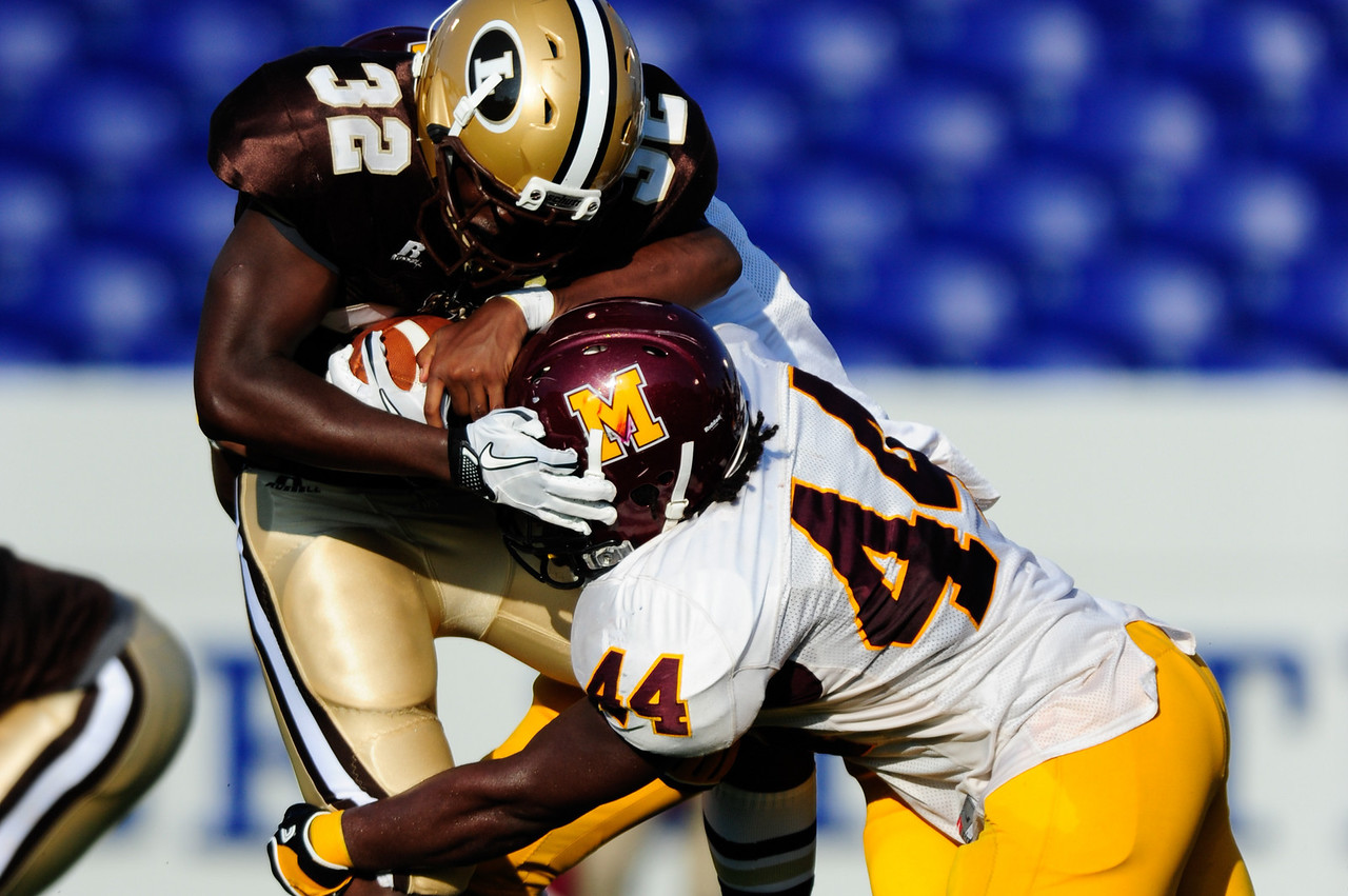 Sept 9, 2011 : McNamara' s Kevaugn Townsend (44) wraps up Landon's Myles Allen (32) during action at the 2011 Patriot Classic Football tournament at the United States Naval Academy Stadium in Annapolis, Maryland. The Landon Bears defeated the McNamara team 29-14.