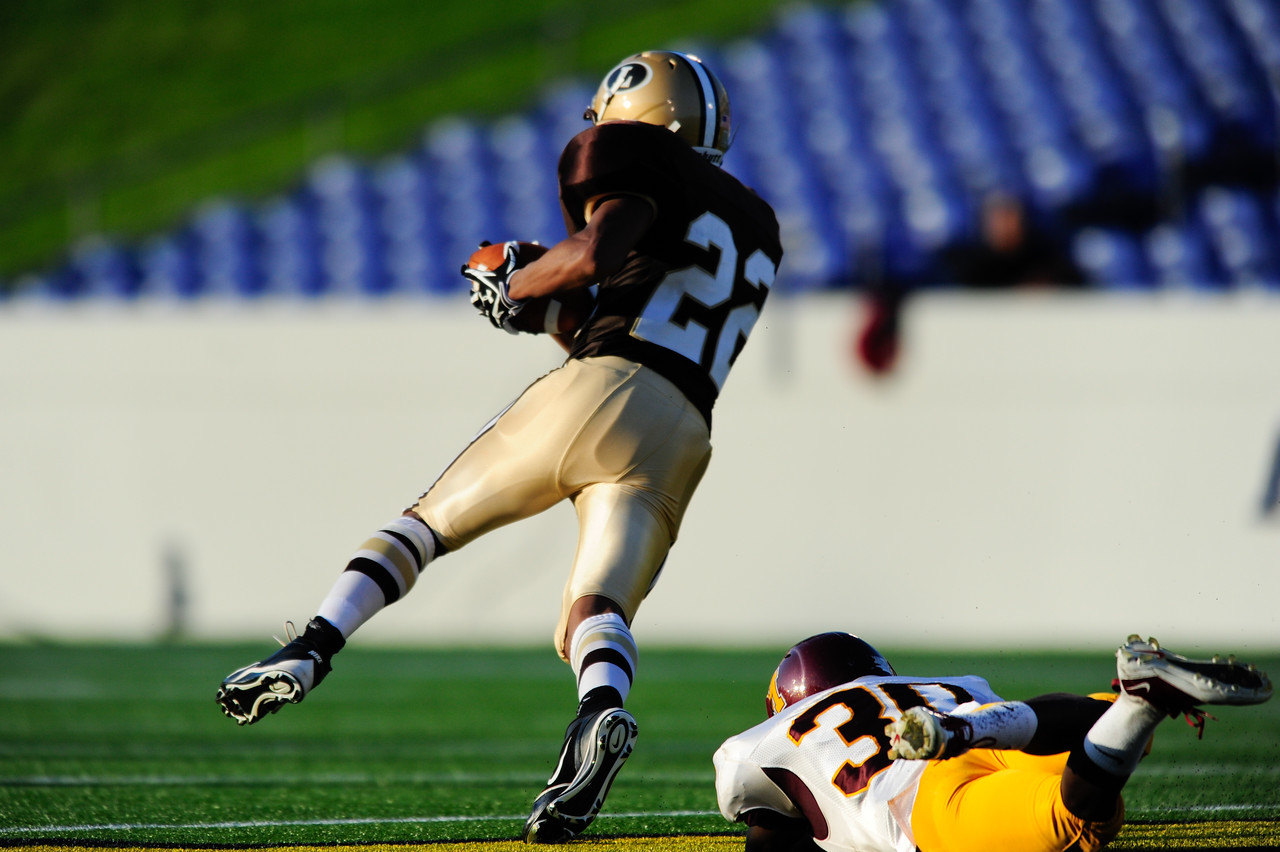 Sept 9, 2011 : Landon's WR (22) Joe McDonald avoids the tackle during action at the 2011 Patriot Classic Football tournament at the United States Naval Academy Stadium in Annapolis, Maryland. The Landon Bears defeated the McNamara team 29-14.