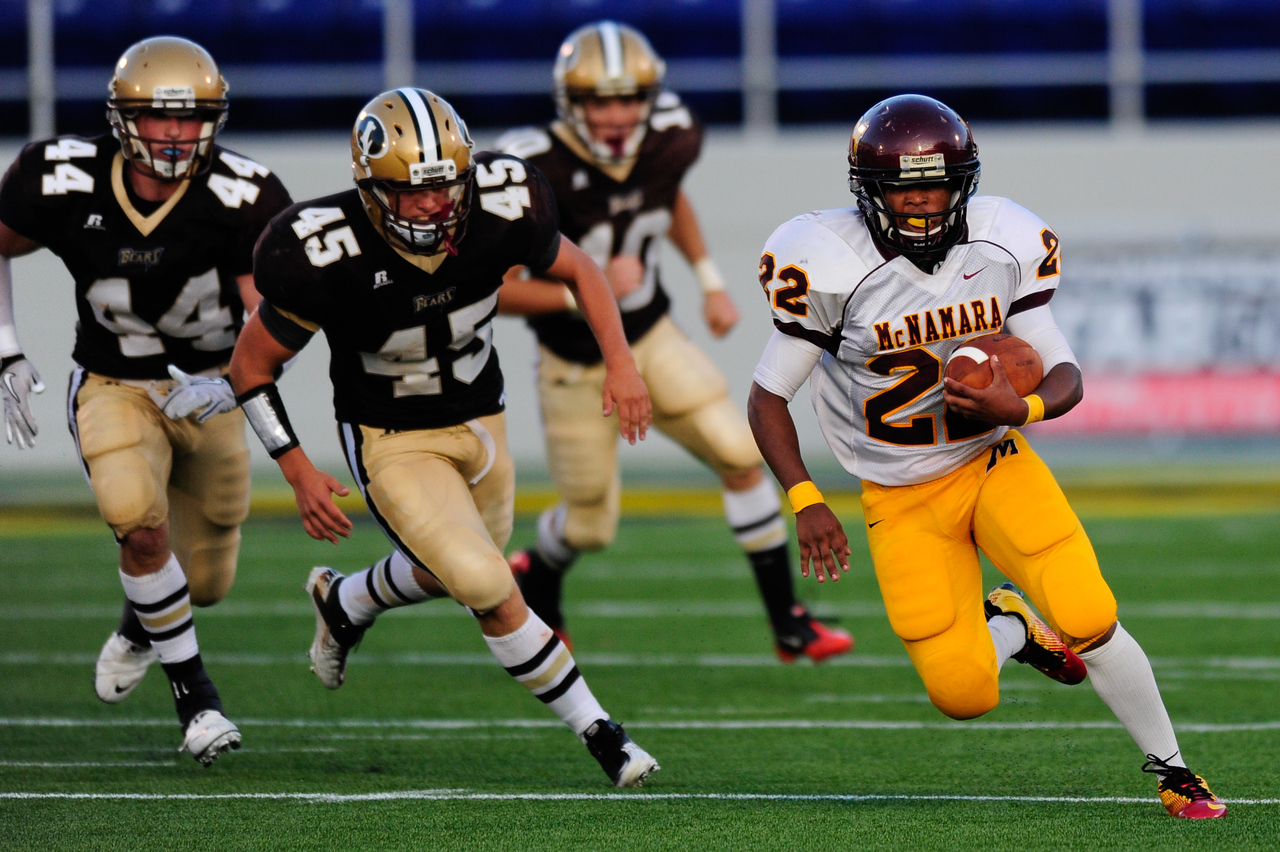 Sept 9, 2011 : McNamara's Tony Squirewell Jr. (23) runs for a gain during action at the 2011 Patriot Classic Football tournament at the United States Naval Academy Stadium in Annapolis, Maryland. The Landon Bears defeated the McNamara team 29-14.