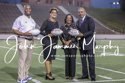 Texas College's Coach Moss, Elissia Burwell and  President Dwight J. Fennell, Sr. are presented with game balls for the Steers first season in the Sooner Athletic Conference.  photo by John Murphy