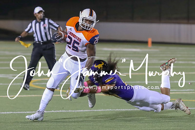 Texas College's #47 Willie Teo-Clifton stops Langstons #25 MArshall Charles. photo by John Murphy