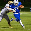 Caeden Constant runs for a first down for Leominster.