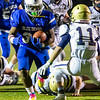 Bryant Cordero runs with the ball for Leominster.