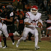 Lindsay Cardinal running back Jacob Hernandez rushes against Woodlake on October 25, 2013.