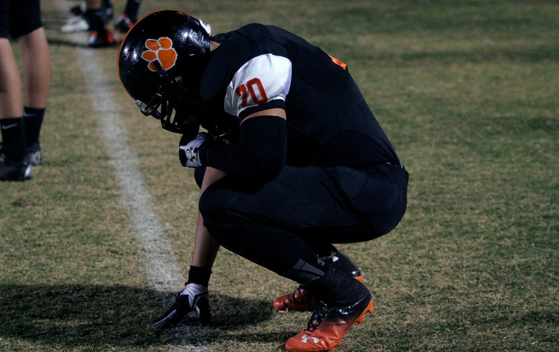 Woodlake Tiger player Augustin Rodriguez has a moment alone before their game against Lindsay.