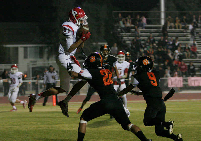 Lindsay Cardinal WR Issac Flores catches a touchdown pass in their 28-0 win over the Woodlake Tigers on October 25, 2013.