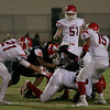 Lindsay gang tackles Tiger running back Elijah Cunningham in Friday night's game. Lindsay won the contest 28-0.