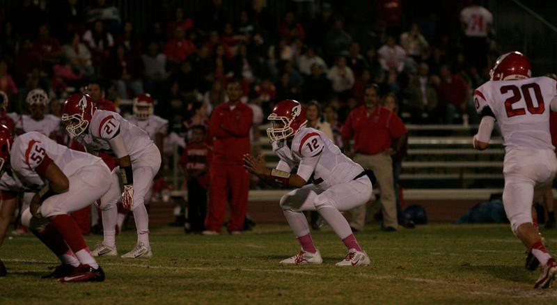 Lindsay Cardinal quarterback Alex Jara call signals against Woodlake on Friday, October 25, 2013.