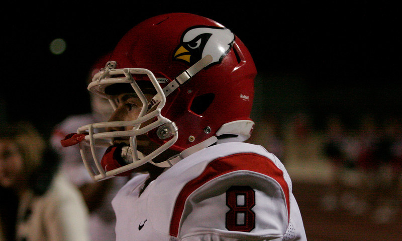 Lindsay Cardinal Isreal Uribe during their game with the Woodlake Tigers on October 25, 2013.