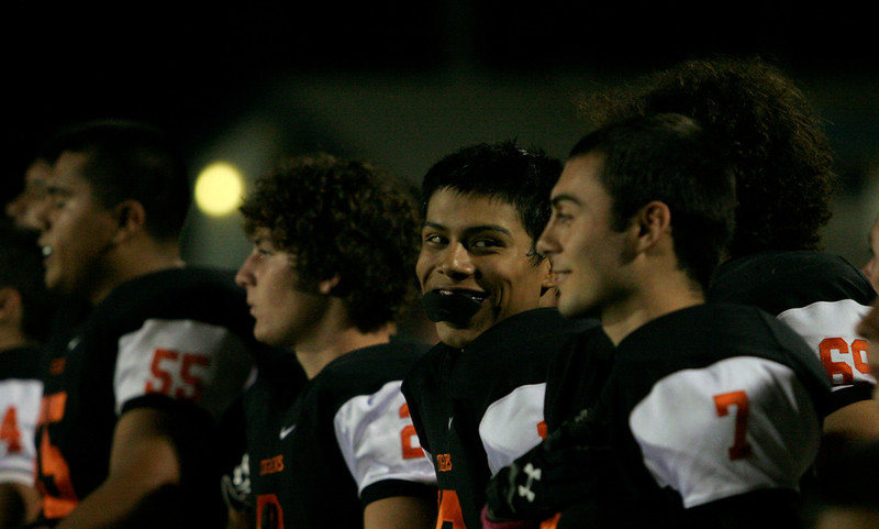 Woodlake Tiger players are relaxed before the game with Lindsay on October 25, 2013.