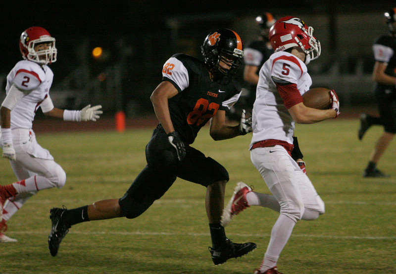Lindsay Cardinal WR Gaven Mann adds yards to one of his 4 receptioins; 2 went for touchdowns.